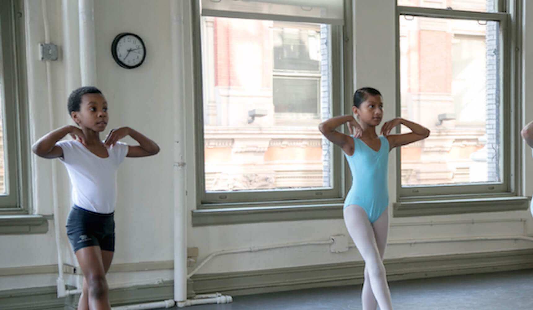 Boy and girl performing ballet in a dance studio
