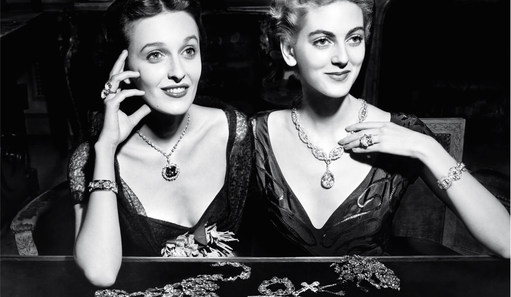 Vintage image of women wearing Harry Winston necklaces at the Harry Winston Court of Jewels