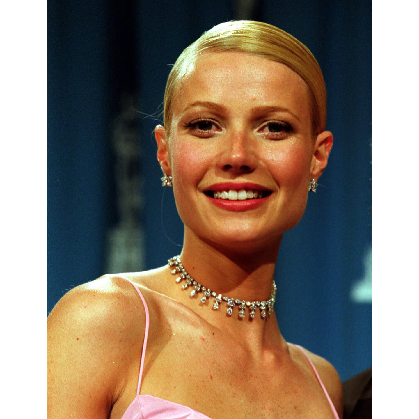Gwyneth Paltrow wearing a diamond necklace from Harry Winston in a pink dress
