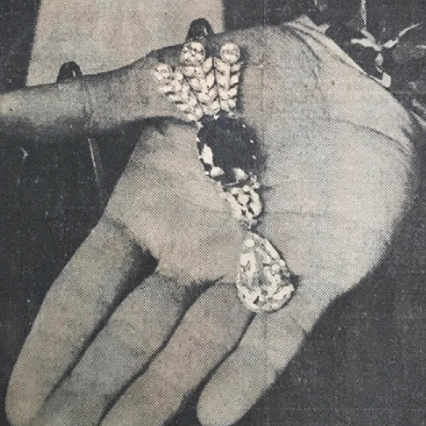 Close up of newspaper clipping featuring an incredible necklace acquired at an estate jewelry auction