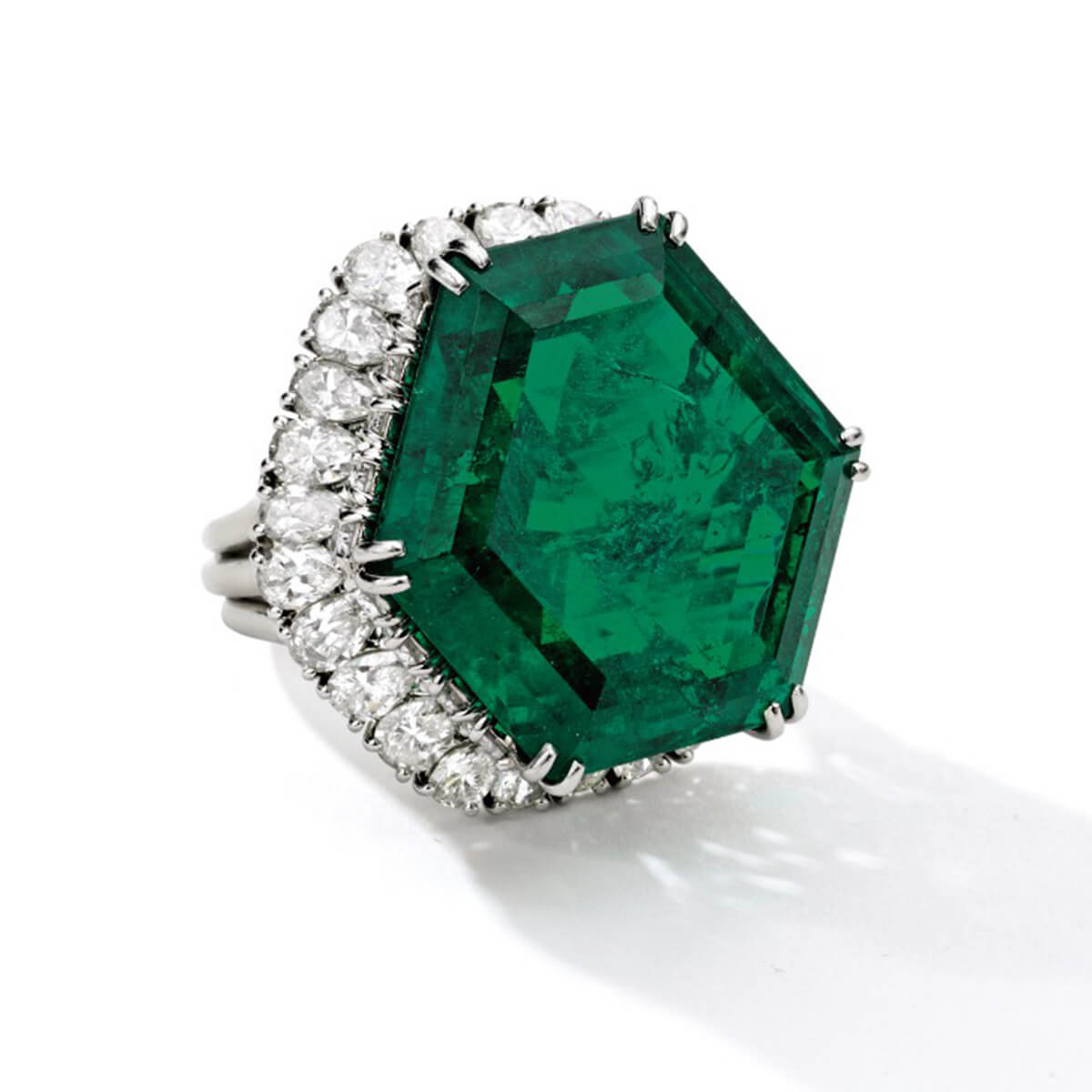 Image of The Stotesbury ring featuring a hexagonal-shaped Colombian emerald center stone weighing a total of 34.40 carats
