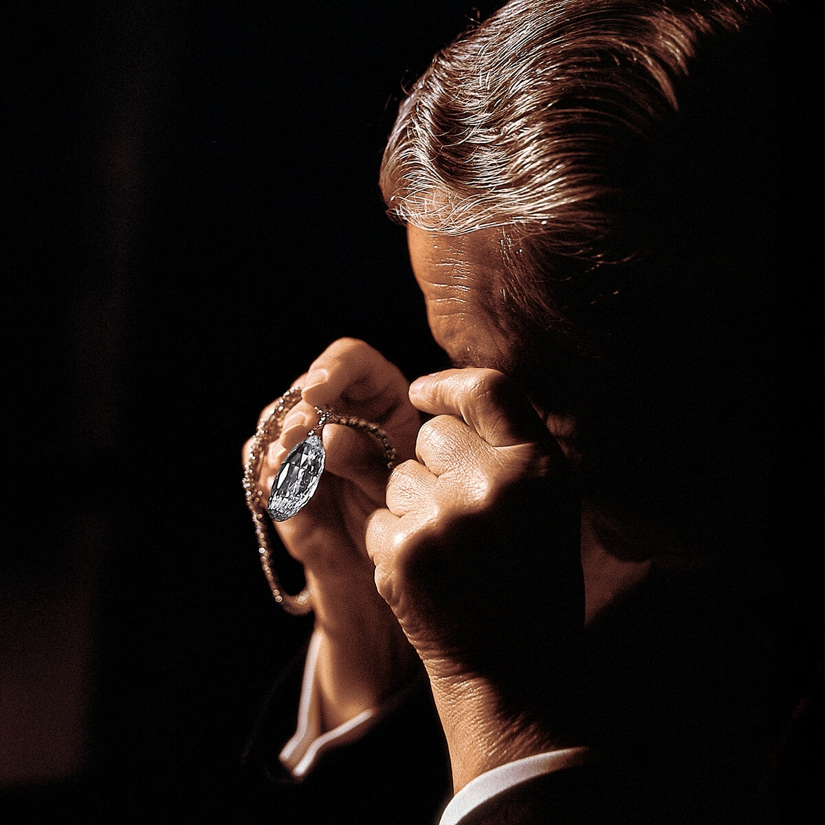 Mr. Harry Winston with a D-color briolette-shaped diamond weighting 90.38 carats