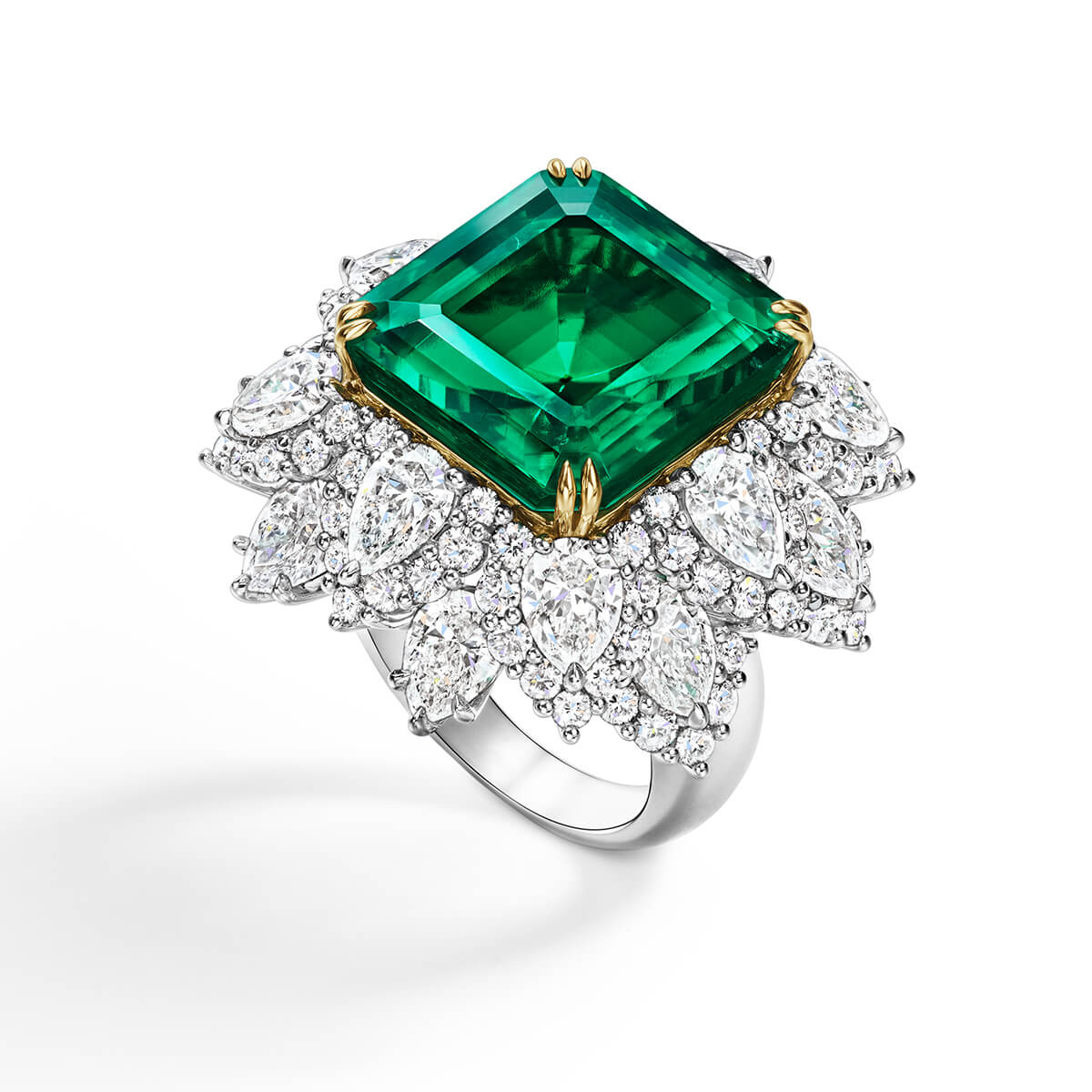 The Rockefeller-Winston ring featuring a square emerald-cut Colombian emerald center stone weighing 18.03 carats with 108 round brilliant and pear-shaped diamonds set in 18 karat yellow gold and platinum